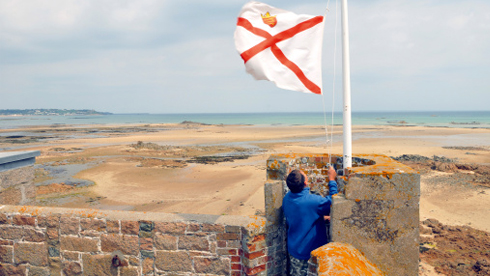 United Kingdom, Jersey, end of La Rocque, Seymour Tower built in the XVIIIe century, Heritage Holidays Bed and Breakfast, Jersey flag