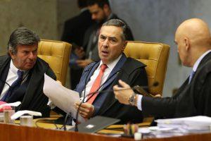 Os ministros Luiz Fux, Luis Roberto Barroso e Alexandre de Moraes, durante sessão do STF que  retoma julgamento sobre o compartilhamento de dados bancários e fiscais.