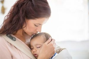 6113-07543276 © Masterfile Royalty-Free Model Release: Yes Property Release: Yes Mother kissing sleeping baby girl
